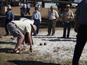 The men are having a smokin'-hot bocce game in Pinecraft Park, measuring distances down to the inch to see who wins.