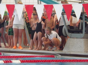 Coach Alivia (the same one whose feet are in the perseverance pic and the post a few weeks ago) cheering on the relay team