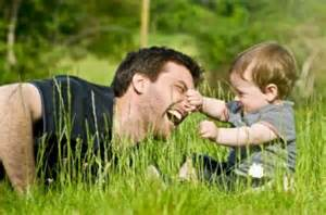 Father playing in field with son