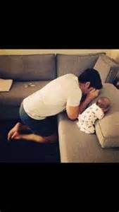 Young Father Praying with Baby