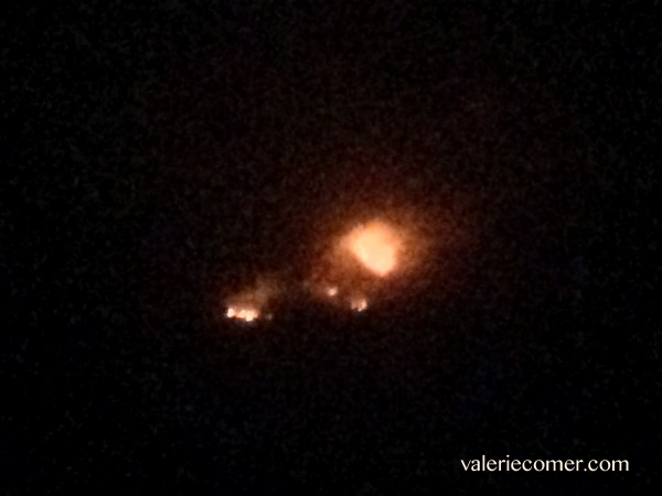 About 10pm on August 14, facing west from my yard (same blaze!) Top photo is the same angle.