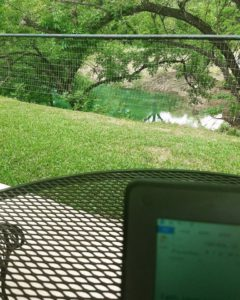 Jolene Navarro writing at the Frio River