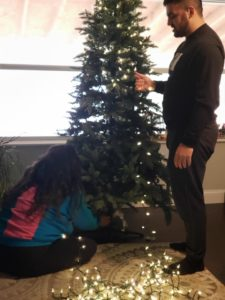 One of my daughters and one son putting on the lights.