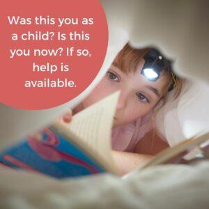 child reading under blanket